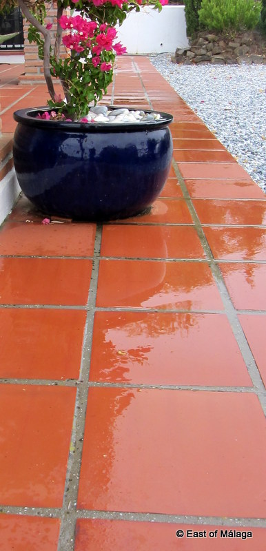 The terrace tiles are wet