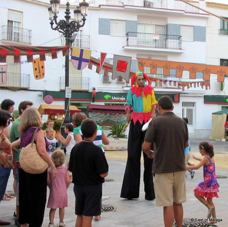 Jester on stilts entertains at the medieval market in Torrox pueblo