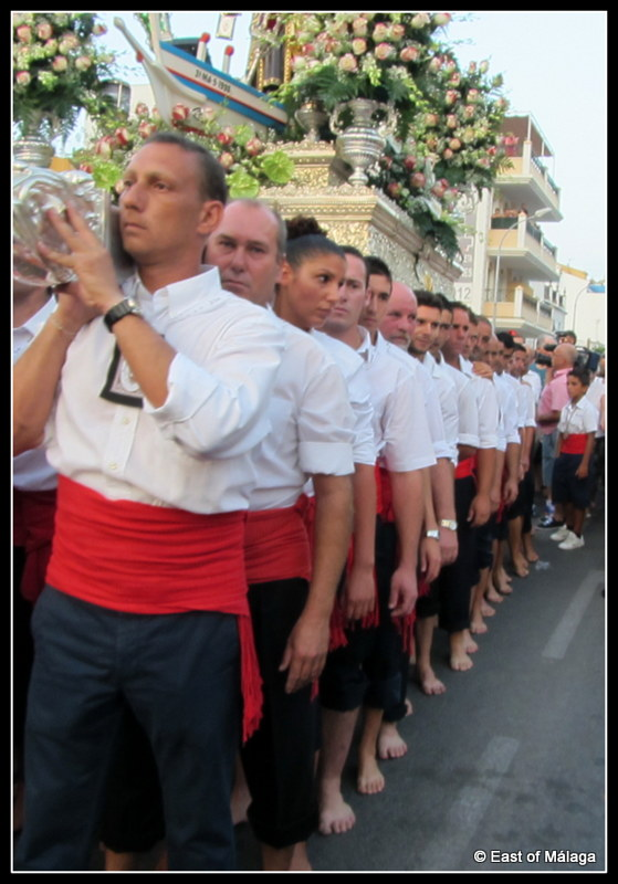 The line of bearers carrying the Virgen del Carmen