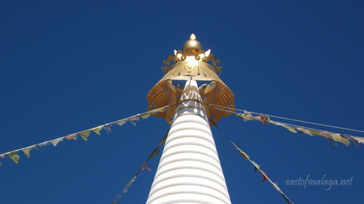The golden dome of the Stupa glistens in the beautiful sunshine