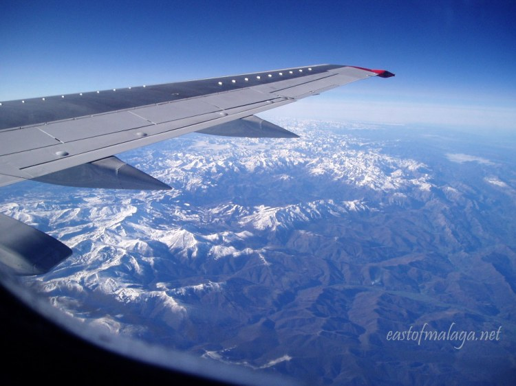 Flying over the snowy mountains of northern Spain, heading south.