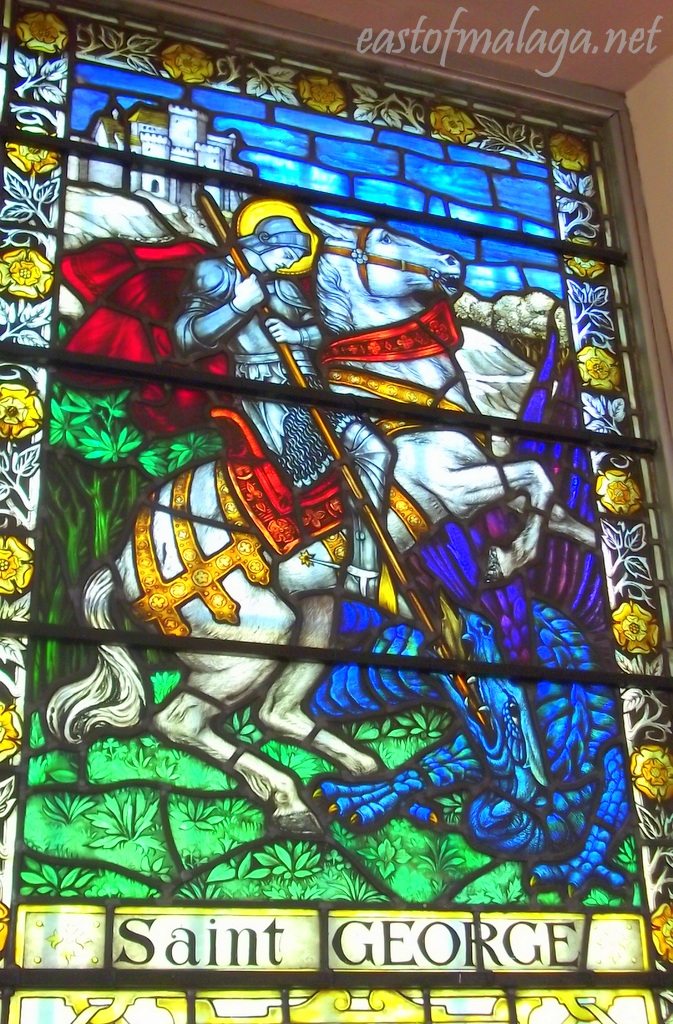 Stained glass window depicting St George slaying the dragon