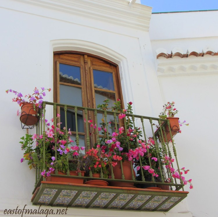Window and pretty balcony in Nerja, Spain