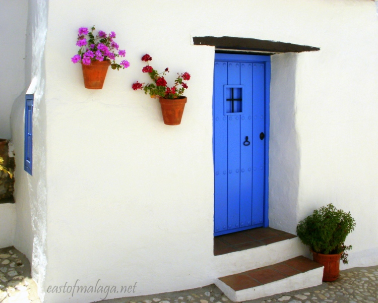 BLUE PAINTED DOOR IN THE HAMLET OF ACEBUCHAL, ANDALUCIA