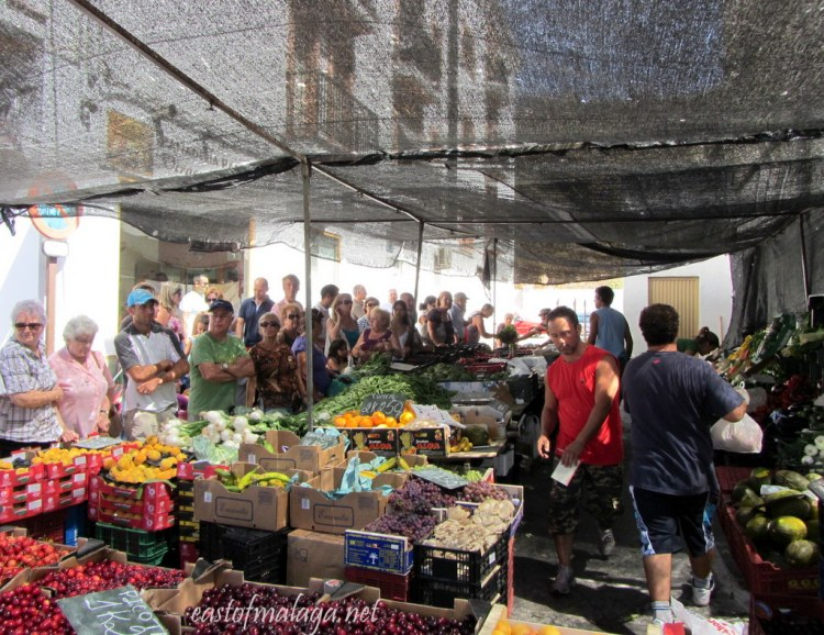 Busy market stall at streetmarket in Spain