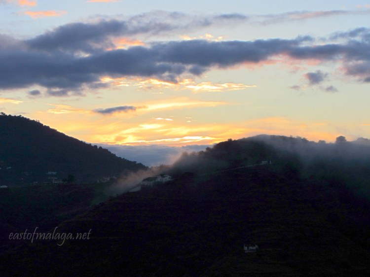 Clouds spilling over the hillside at sunset in southern Spain
