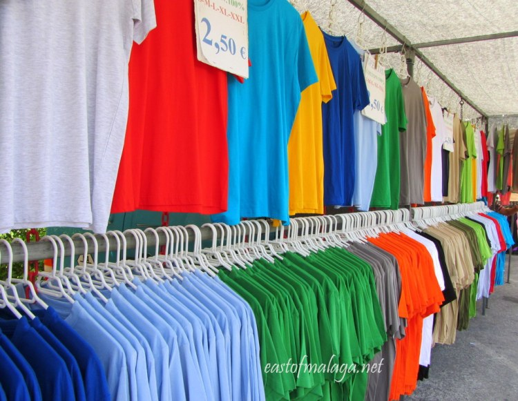 Many coloured tee-shirts on sale at the Spanish market