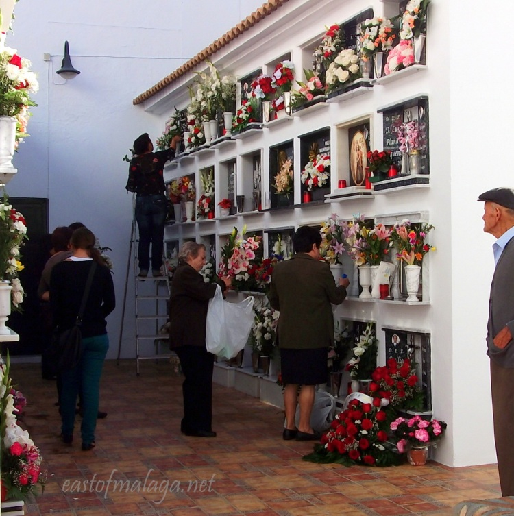Tending the graves in Competa cemetery for Todos Los Santos