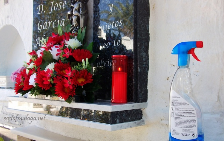 Cleaning the gravestones in Competa cemetery, Spain