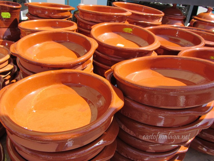 Terracotta cazuelas at a Spanish streetmarket