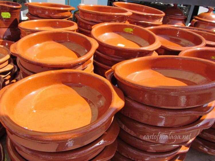 Terracotta cazuelas at a Spanish streetmarket