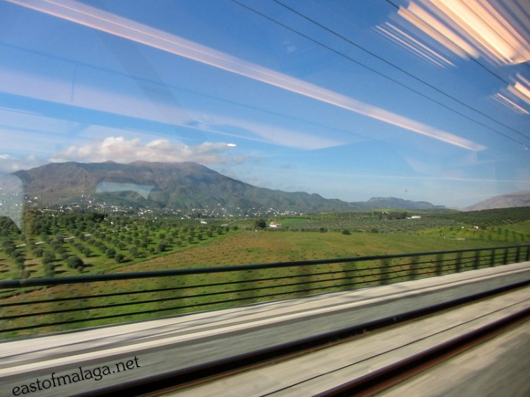 The Spanish countryside flashes by as we travel on the AVE train