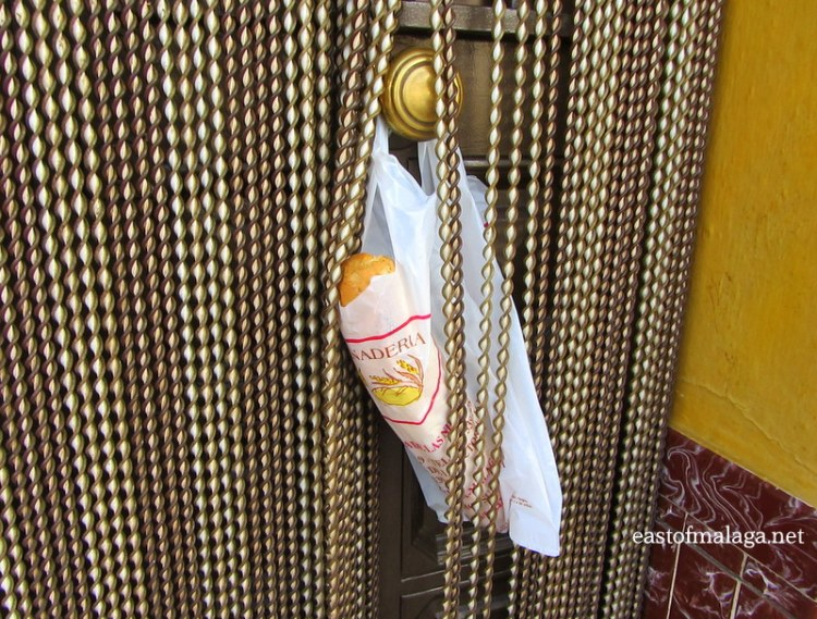 Bread hanging from a doorknob in Torrox, Spain