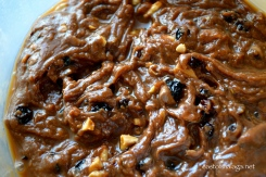 Stir the fruit and nuts into the chocolate mixture