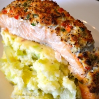 Salmon fillet with a zingy coconut and coriander crust and leeky mash