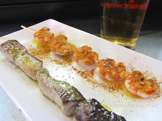 Tapas of skewered tuna and prawns
