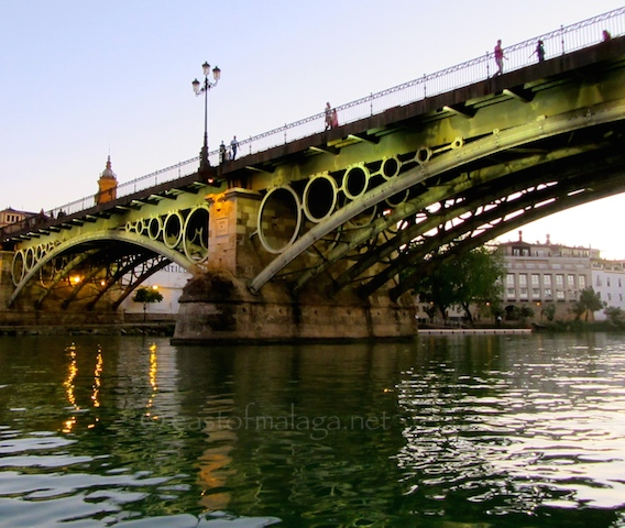 Cruising under Triana Bridge, Seville