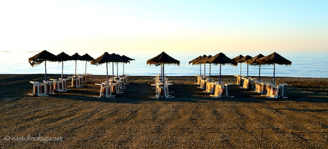 Early morning sun strikes the waiting sun beds - Torre del Mar, Spain