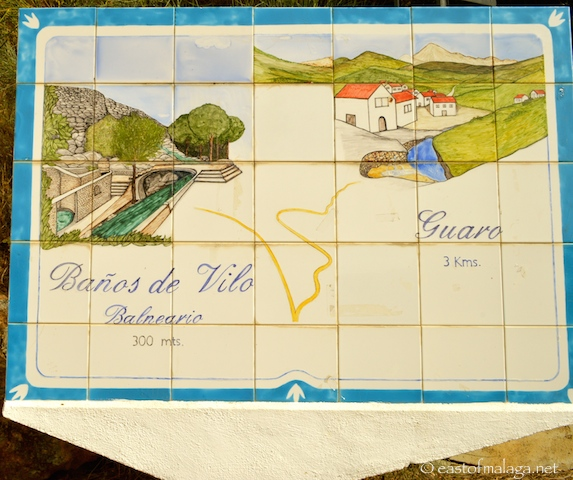Tiled sign showing the way to the Baños de Vilo, Periana