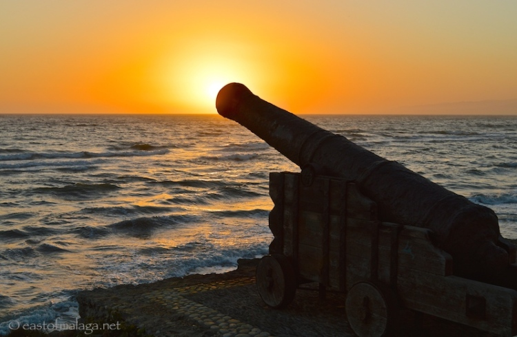 Sunset behind the cannon at Torrox Costa, Spain